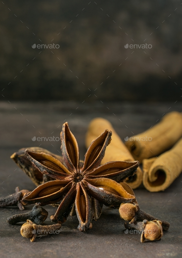 Aniseed star, cinnamon sticks and cloves  - Stock Photo - Images