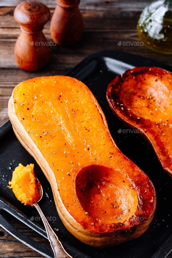 Baked butternut squash pumpkin, ingredient for a warm fall soup. - Stock Photo - Images