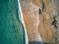 Beautiful beach with family top view shot - PhotoDune Item for Sale
