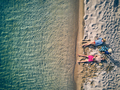 Beautiful beach with family drone shot - PhotoDune Item for Sale
