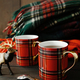 Holiday mugs with hot tea on wood table - PhotoDune Item for Sale
