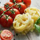 Uncooked pasta bunches with tomatoes - PhotoDune Item for Sale