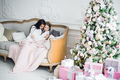 Christmas Eve. family mother and child daughter reading magic book at home on a sofa near Christmas - PhotoDune Item for Sale