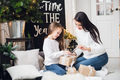 Merry Christmas and Happy Holidays. Cheerful mom and her cute daughter girl exchanging gifts. Parent - PhotoDune Item for Sale