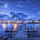 Fishing boats near pier on the sea and snowy mountains at night - PhotoDune Item for Sale