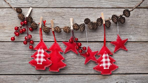 timeless design e166e bce49 Christmas felt decorations hanging on stick with pine cones