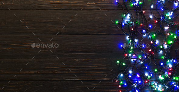 Colorful Christmas Lights Background.Colorful Christmas Lights On Dark Wooden Background
