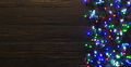 Colorful christmas lights on dark wooden background - PhotoDune Item for Sale