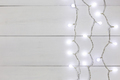 Border of christmas garland lights on wooden background - PhotoDune Item for Sale