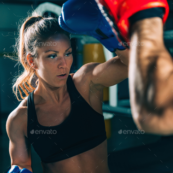Woman on boxing training with trainer - Stock Photo - Images