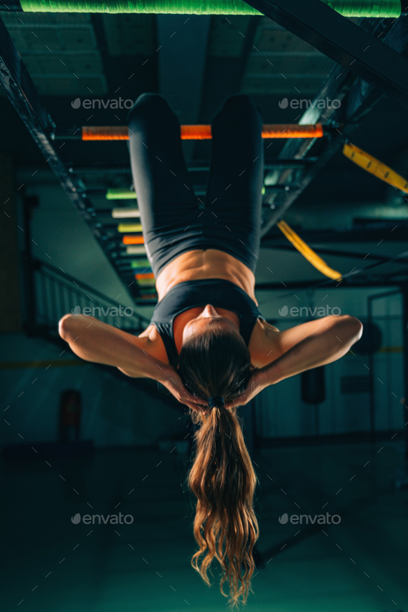 Woman on boxing training doing crunches - Stock Photo - Images