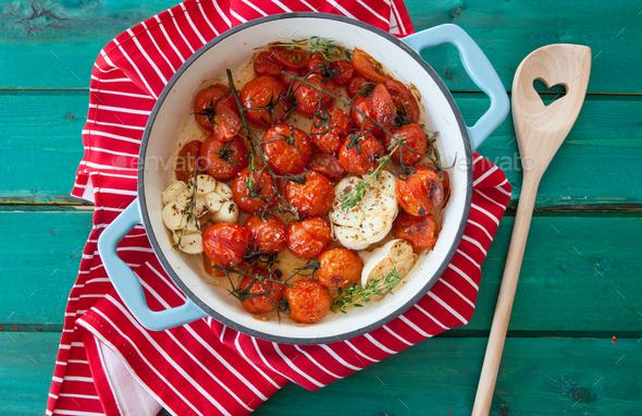 Roasting tomatoes with garlic - Stock Photo - Images