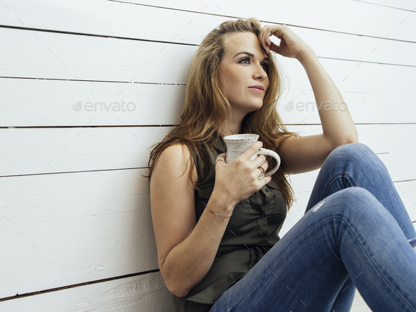 Gorgeous brunette woman drinking coffee - Stock Photo - Images