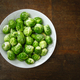 Brussels sprouts on old wood table - PhotoDune Item for Sale