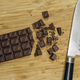 Chopping chocolate for baking - PhotoDune Item for Sale