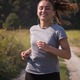 Free Download woman jogging along a country road Nulled