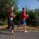 Free Download young couple jogging along a country road Nulled