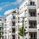 The facade of some white modern apartment buildings - PhotoDune Item for Sale