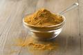 Bowl with yellow turmeric  powder - PhotoDune Item for Sale
