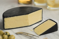 Piece of English waxed farmhouse cheddar cheese - PhotoDune Item for Sale