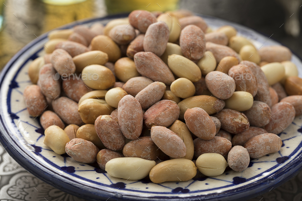 Bowl with traditional Moroccan roasted peanuts - Stock Photo - Images