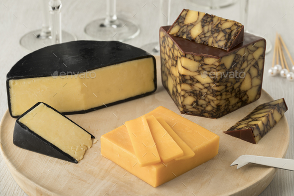 Cheese board wirh  Irish Cahills porter cheese, Irisch cheddar a - Stock Photo - Images