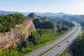 highway in mountainous area with danxia landform - PhotoDune Item for Sale