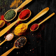 Different spices placed in spoons - PhotoDune Item for Sale