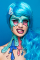 Fashionable zombie girl. Portrait of a pin-up zombie woman. Halloween make-up. - PhotoDune Item for Sale