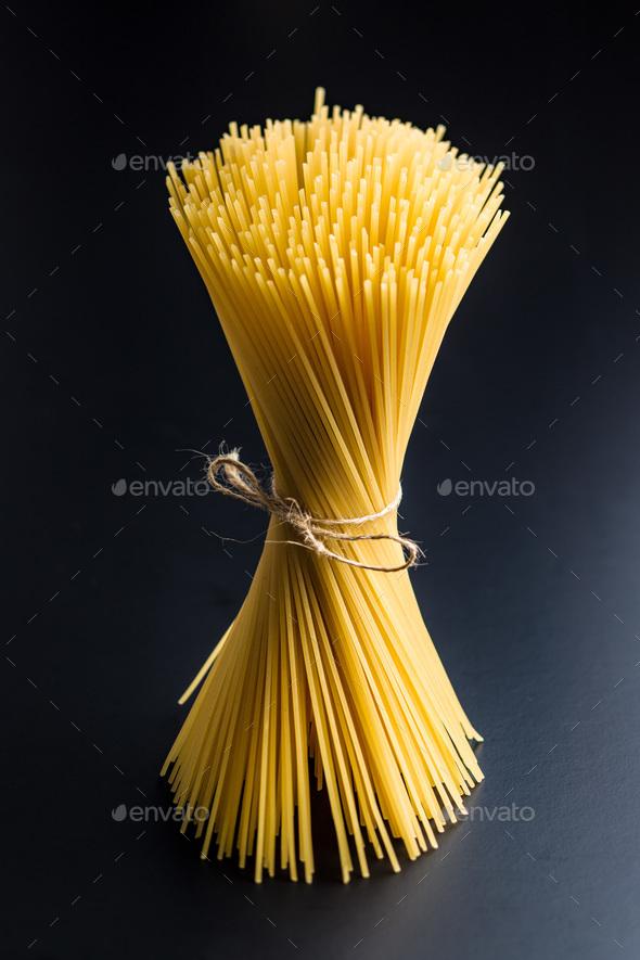Uncooked spaghetti pasta. - Stock Photo - Images