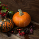 Fall table centerpiece with viburnum and pumpkins - PhotoDune Item for Sale
