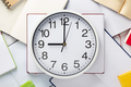 wall clock and open notebook or book - PhotoDune Item for Sale