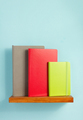 notepad and book on shelf at wall background - PhotoDune Item for Sale