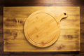 pizza or bread cutting board at wooden table - PhotoDune Item for Sale