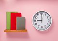 notepad and clock on shelf at wall background - PhotoDune Item for Sale