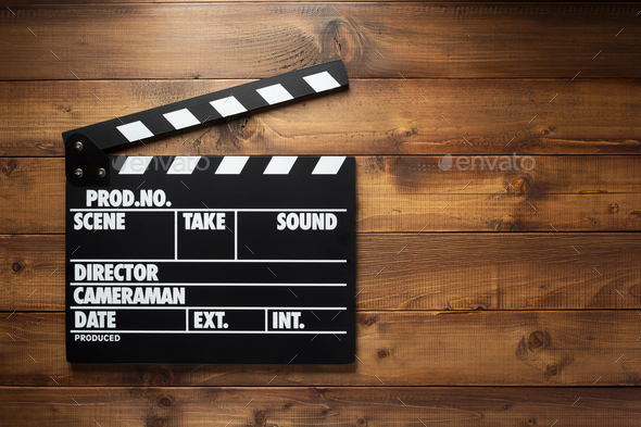 movie clapper board at wooden background - Stock Photo - Images