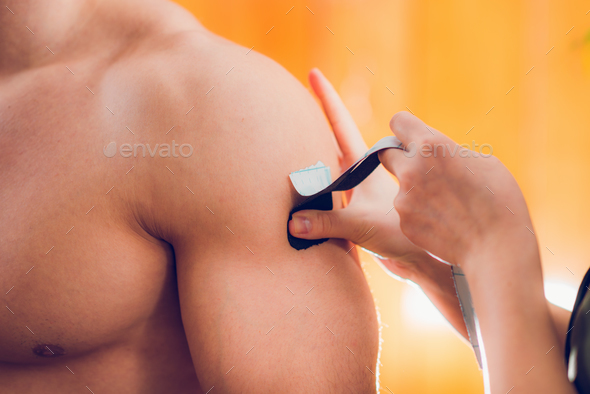 Kinesio taping for shoulder pain - Stock Photo - Images