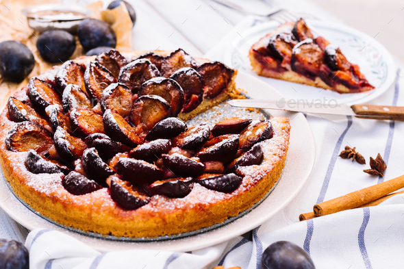 Homemade plum pie on the wooden background - Stock Photo - Images