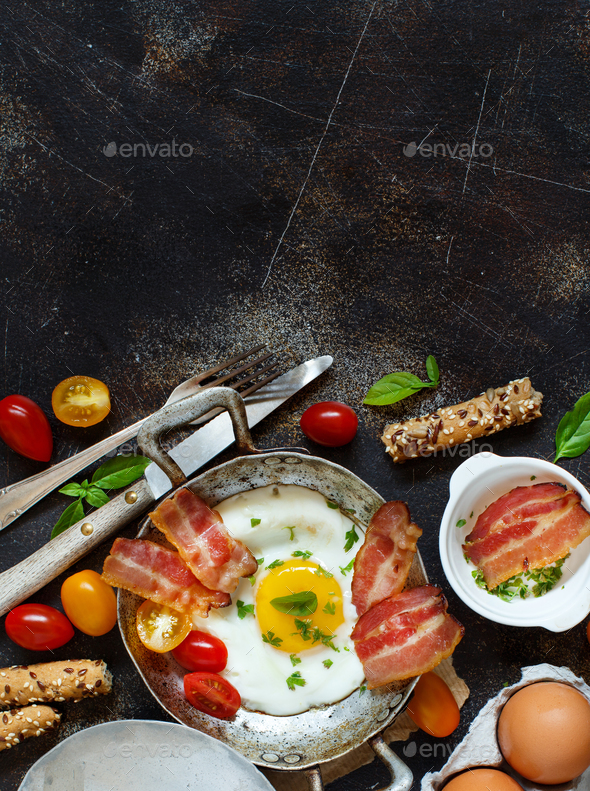 Breakfast with fried eggs and bacon - Continental breakfast - Stock Photo - Images