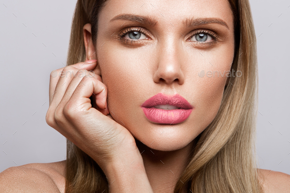 Beautiful young model with pink lips. Nude manicure - Stock Photo - Images
