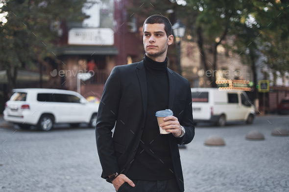 Young businessman going to the work with coffee - Stock Photo - Images