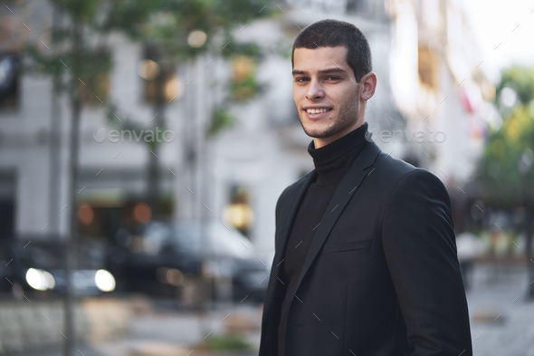 Handsome young male walking on the street - Stock Photo - Images