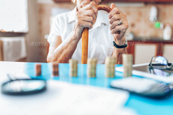 Senior woman checking her finances and investments - Stock Photo - Images