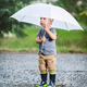 Adorable child holding an umbrella in a rain storm - PhotoDune Item for Sale