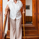 Elderly woman at home using a cane to get down the stairs - PhotoDune Item for Sale