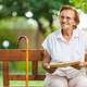 Elderly woman sitting and relaxing on a bench in park - PhotoDune Item for Sale