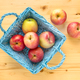 Red apples in blue wooden basket - PhotoDune Item for Sale