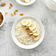 Oats porridge with banana slices and nuts - PhotoDune Item for Sale