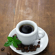 a cup of black coffee with roasted coffee beans and leaves on white background - PhotoDune Item for Sale