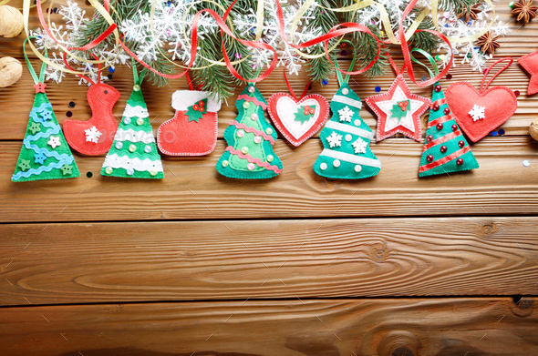 Handmade rustic felt Christmas tree decorations as background on - Stock Photo - Images
